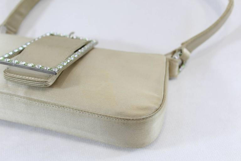 Really nice small Jimmy Choo weeding bag in silj with maxi lock with Swarovsky crystals.  Good condition but some signs of wear in corners. Small stain in one corner (see images)