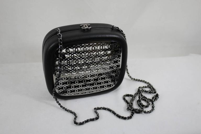 For sale clutch from the Paris Dubai cruise collection. It is mande in black leather and steel.  It takes the grill that were decorationg  really good conditon.  This is a Sample made for the collection.  No hologramme inside  Size 14x16 cm