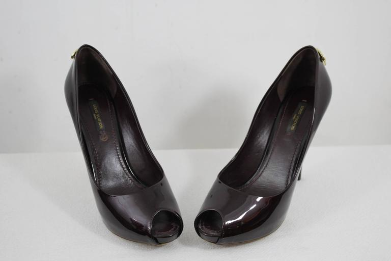 40d5d736f096 For sale nice pair of Louis Vuitton shoes in dark purple patented leather  with a lock