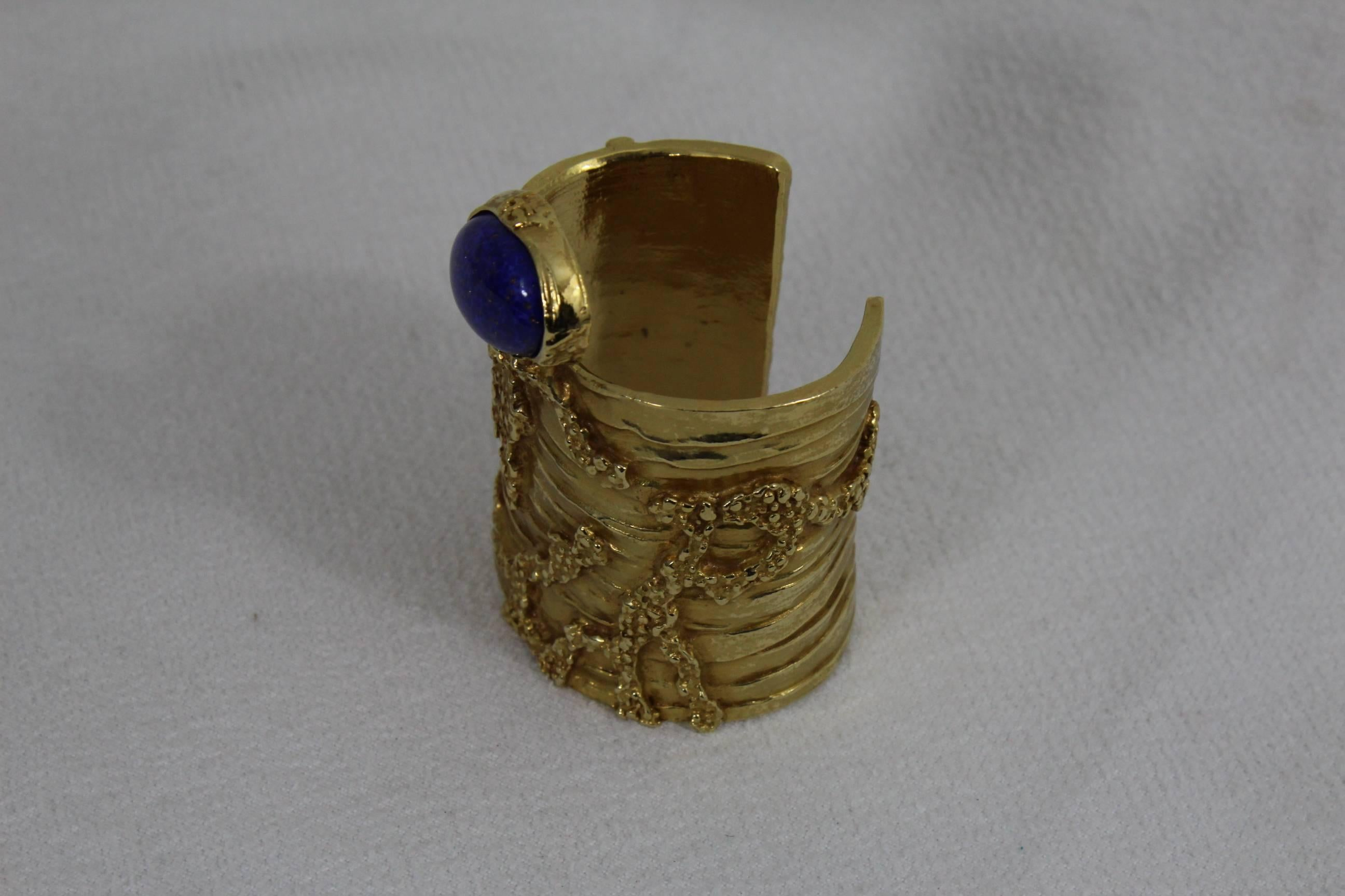658d6804f74 Yves saint Laurent Gold Artsy Bangle with Blue Stone For Sale at 1stdibs