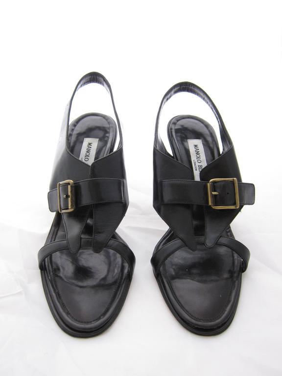 Really nice Manolo Blahnik Black Leather Sandals in blakc leather an  d brass hardware.  Size Us 7 (french 38 and a half)  Good condition. Some light signs of wear