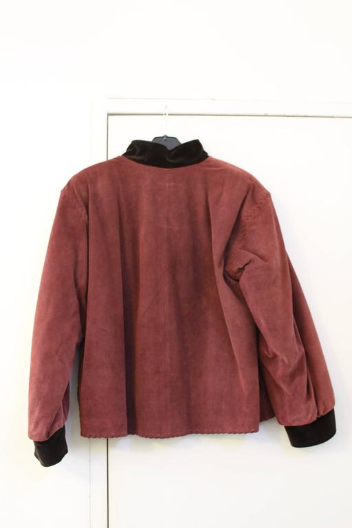 Really nice jacket from yves saint Laurent from russian inspiration in leather. Really good condition. Size 36 (small to xs) Really warm it iss doubled inside