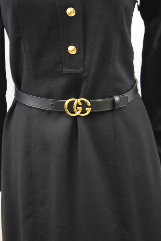Really nice Gucci Dress in wool and leather sold with its black leather belt with golden Boucle.  Size europen 40