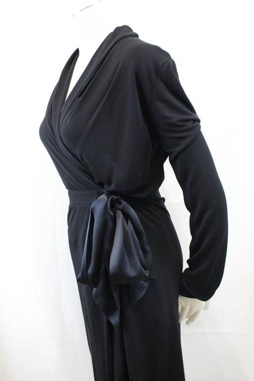 Really nice dress from Yves Saint Laurent in black viscose and a closing ribbon.  Class and confortable.  Size S