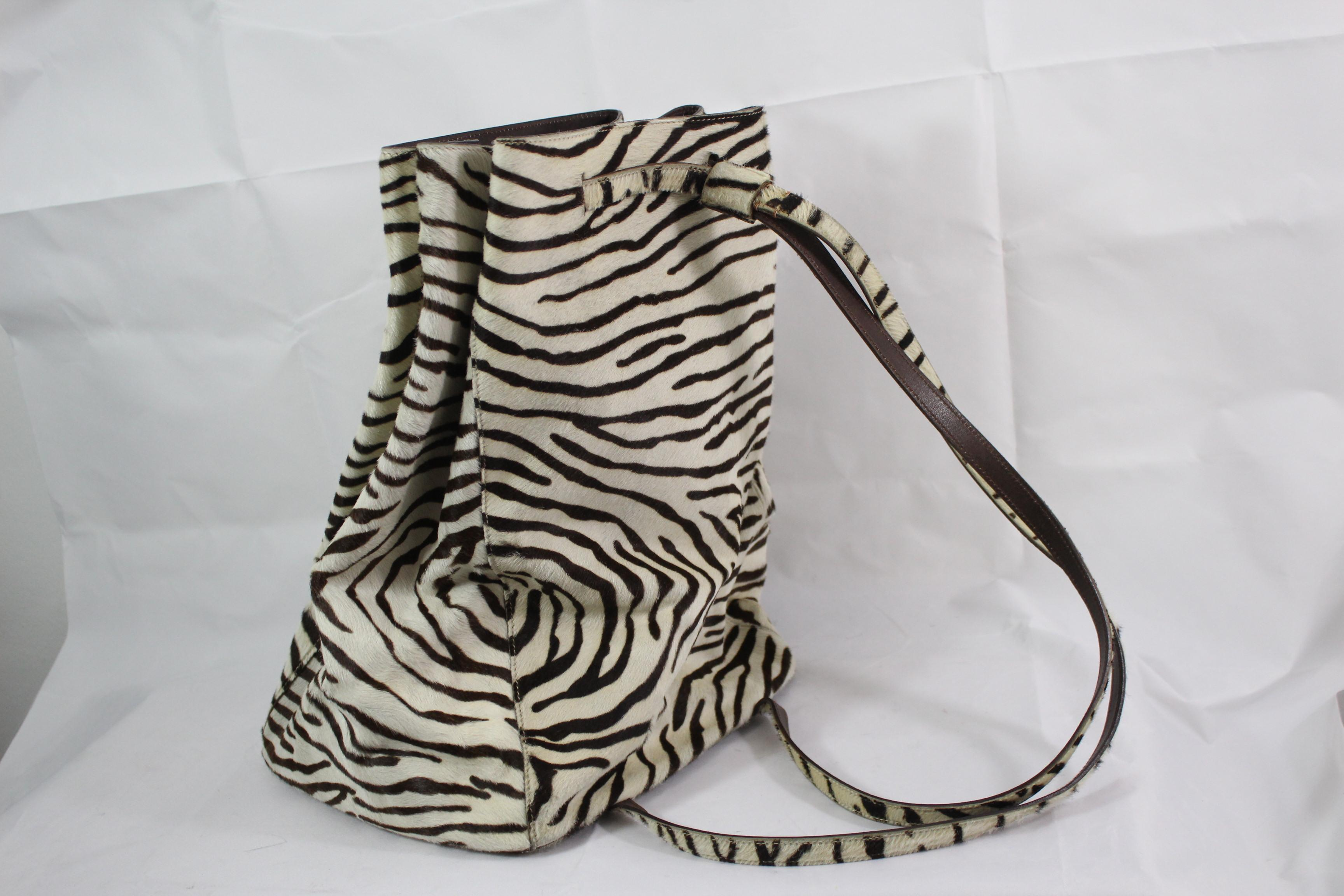 e8363ba0fa72 ... authentic prada zebra style leather backpack in excellent condition for  sale in paris fr f28c6 0c7d1