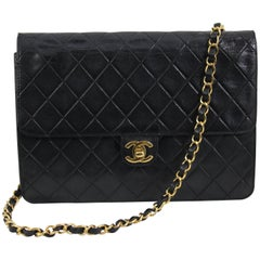 Vinatge Chanel Black Leather Shoulder Bag. New Clasp and chain