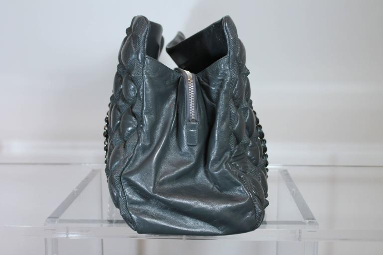 """Rare perfection for the ultimate Chanel collector. This hard to find Chanel bubble pyramid tote comes fro the Fall 2009 collection -  """"Paris-Moscou"""" - which was Lagerfeld's theme for his semiannual collection. Dark Grey supple calfskin. Silver"""