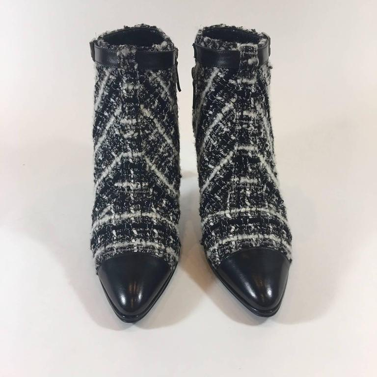 """Stand tall in these stunning Chanel Boucle tweed ankle boots. Black leather toe, shiny patent heel and decorative black leather side buckle. Size zipper.  Size 40. Made in Italy. Never Worn. 3.5"""" covered heel."""