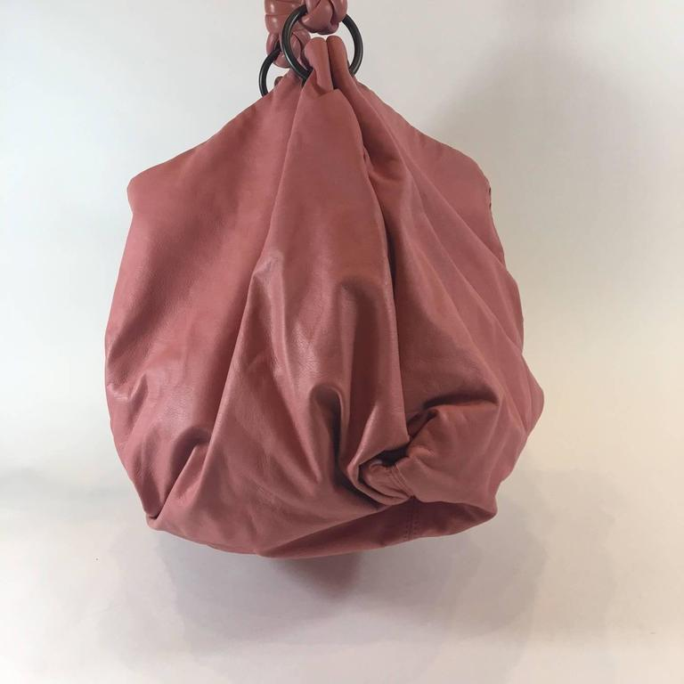 """This soft and luxurious Bottega Veneta bag is known as the Petal Woven Leather Aquilone Fortune Cookie Hobo Bag. Made in Italy and featuring Bottega's signature intrecciato woven leather details in a pale pink """"Petal"""" color. Antique brass hardware."""