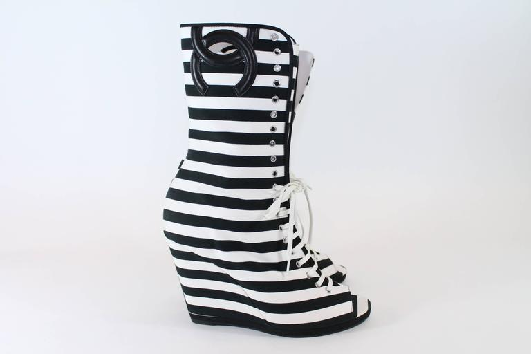 Size 41. These boots have a 4 inch canvas wrapped wedge. They are calf length with a black stitched Chanel logo at top of boot. Black and white stripes on entire shoe. Open toed with white laces. black leather soles.