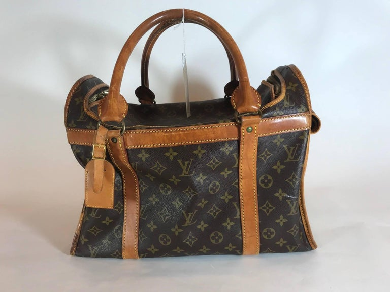 Signature monogram canvas featuring  natural cowhide leather trims. Gold-tone hardware. Gold-tone breathable mesh window. Dual top rolled handles. Roll-up flap with snap fastener. Top-zip around closure. Water-resistant brown nylon interior. Lock