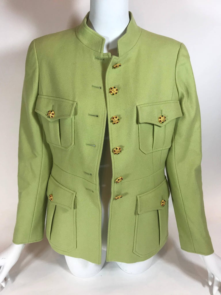 Bright green wool. Gold-tone hardware. Button up closure. Four exterior Military style pockets. Collared. Three button up closures on sleeves.