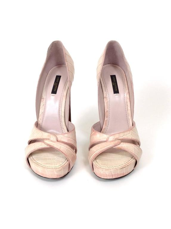 These feminine and gorgeous Louis Vuitton platform sandals are in antique-looking distressed pink crocodile embossed leather with chunky heel.  Measurement: Label size 40 Italian Heel height 6 inch Platform 1,25 inch