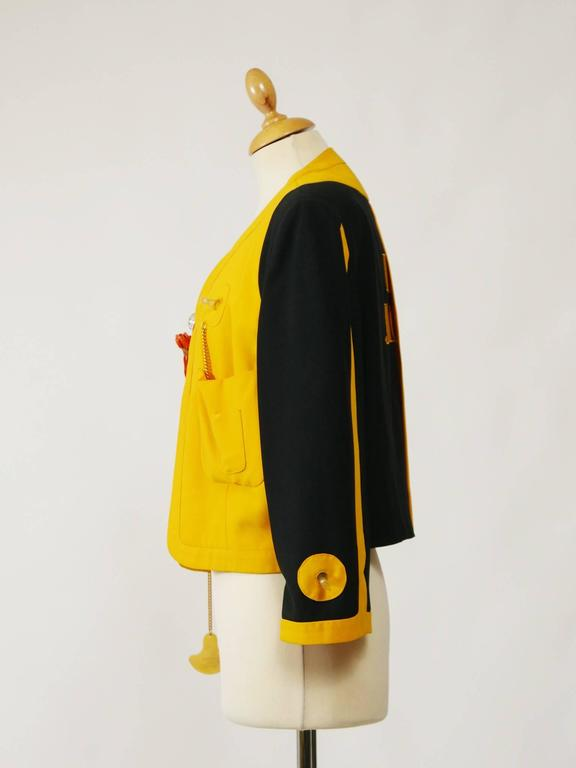 """This amazing life-saving style jacket is from the 1989 """"Cruise Me Baby"""" collection. It's fully lined with black satin.  Very good vintage condition  Label: Moschino Couture - Made in Italy            Moschino Cruise Me Baby Fabric:"""