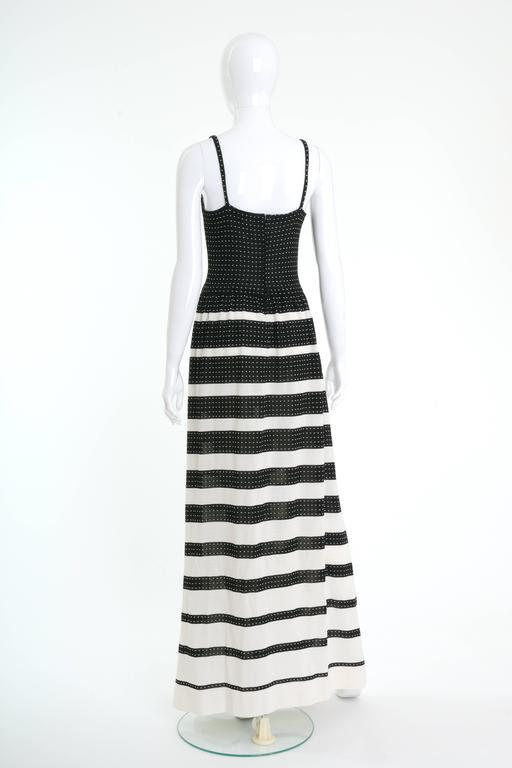 This lovely 1970s Lanvin long dress is in black and white knitted fabric with striped print skirt. It has spaghetti straps and back zip closure.   Very good vintage condition  Label: Lanvin Paris Fabric: polyester  Color :