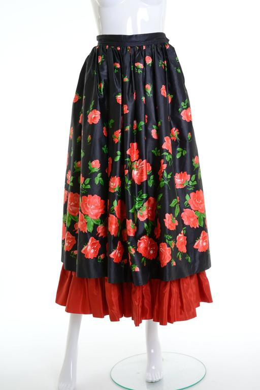 This amazing 1980s Saint Laurent Rive Gauche skirt is in a black silk taffeta fabric with red floral print. It has double pleated skirt with red flaunced under skirt. It has side pockets and zip and hook closure.   Good vintage condition(The label