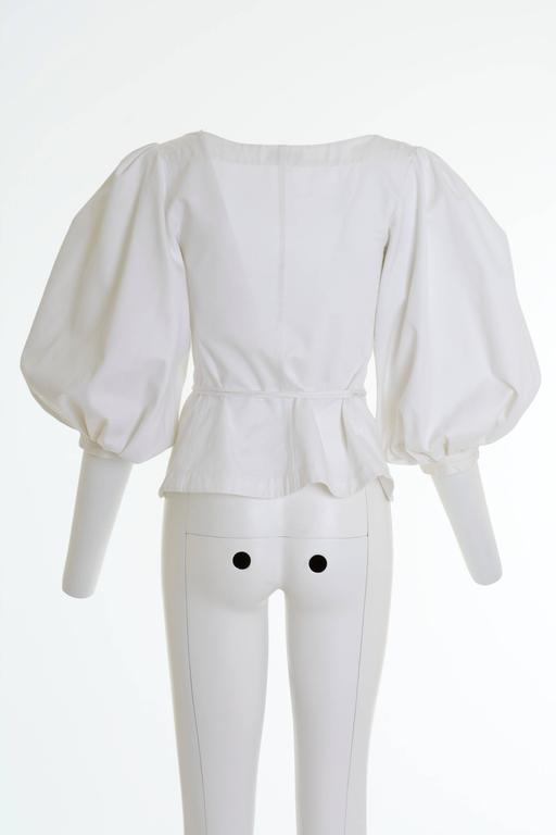 This amazing and iconic YVES SAINT LAURENT Rive Gauche 1990s blouse shirt is in a white pique cotton fabric with large balloon sleeve and lace up closure.  Very good vintage condition  Label: Yves Saint Laurent Rive Gauche (made in France) Fabric: