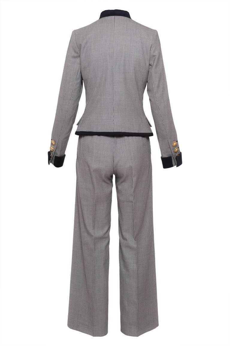 This lovely YSL Suit Pants is in cotton pied de poule fabric. The Jacket has double breasted closure with metal gold button, two faux frontal pocket and also two front pocket, three buttons in the sleeves and is fully lined . The pants have two