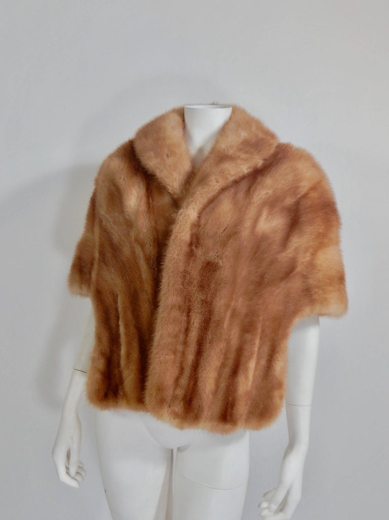 Gorgeous 1950s / 1960s Mink Stole by Evans, Paris Milan Chicago. Hand Pockets. Fully lined in silk. Embroidered on the inside lining where there is usually a name or monogram is the Spanish word Chiquita which means, baby, honey, doll, etc.  Size