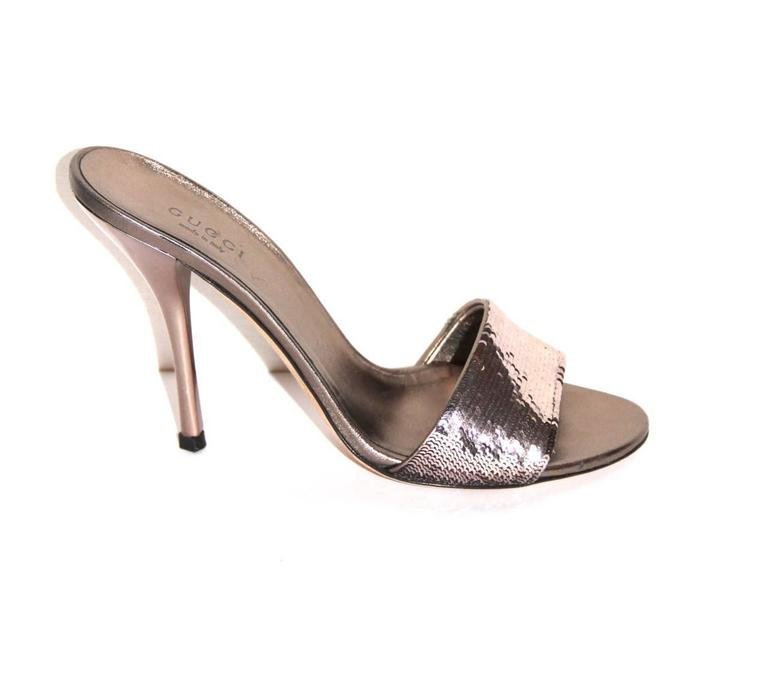 Dazzling evening mules from Gucci.  Collection: 2018 Fabric: Sequins, cloth, sole leather, insole leather Color: Gold-pink tone Size: 36 Heels: 11 cm Condition: Very good Comes with: Dust bag and box   All items are subject to a strict quality