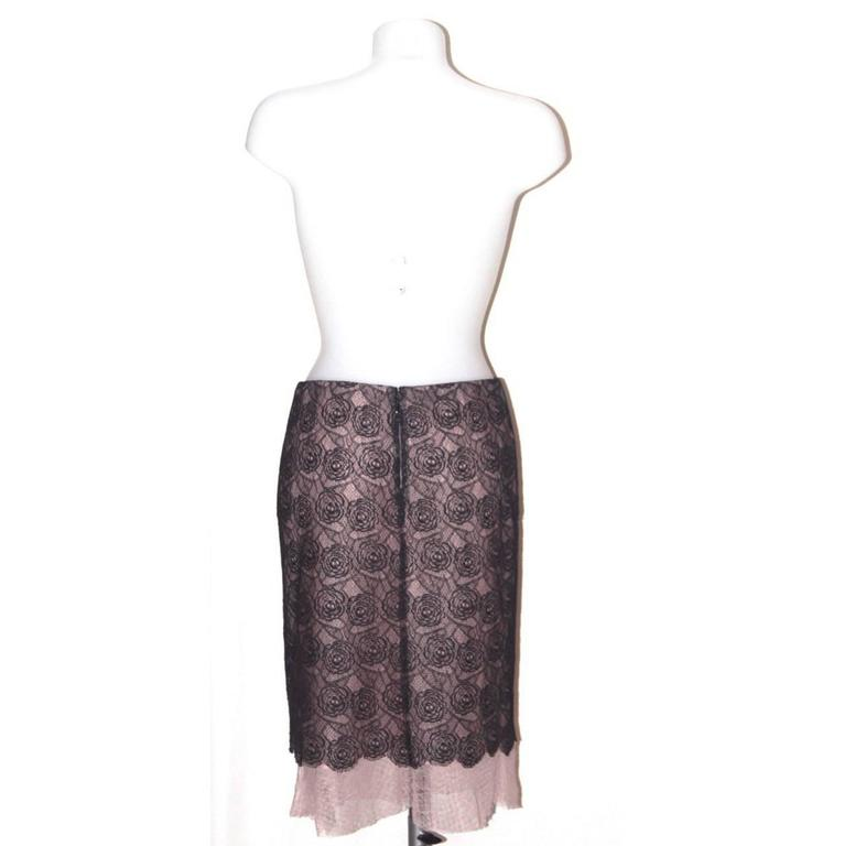 Both delicate and sophisticated, this skirt from Chanel is a must-have for a romantic look.   Collection: Spring 03 Fabric: Lace: cotton blend; Under dress: polyamide; Lining: silk Color: Blush pink, black Size: FR 38  Measurements: Lenght: 60