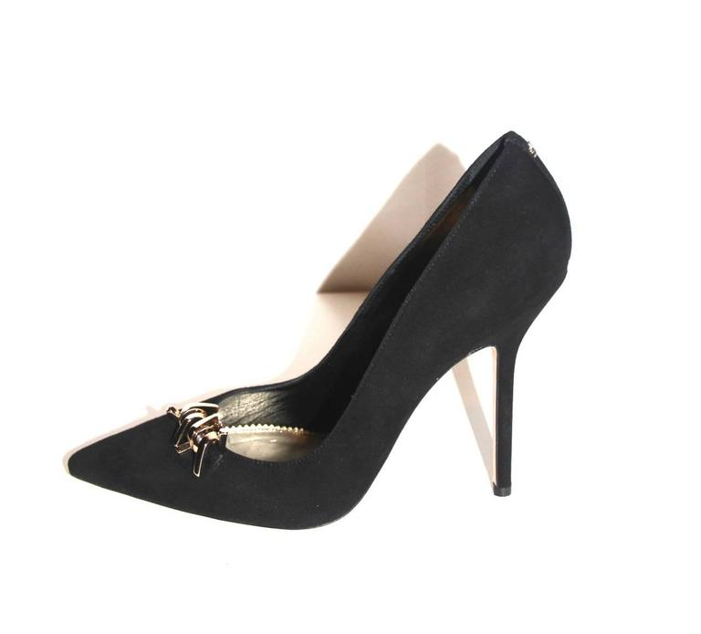 """These """"Babe Wire"""" stilettos from Dsquared2 feature a metallic decor that injects a rock-glam look and the narrow toeline adds a sharp touch to this sensual style.   Collection: Current Fabric: Suede, gold leather lining Color: Black Size:"""