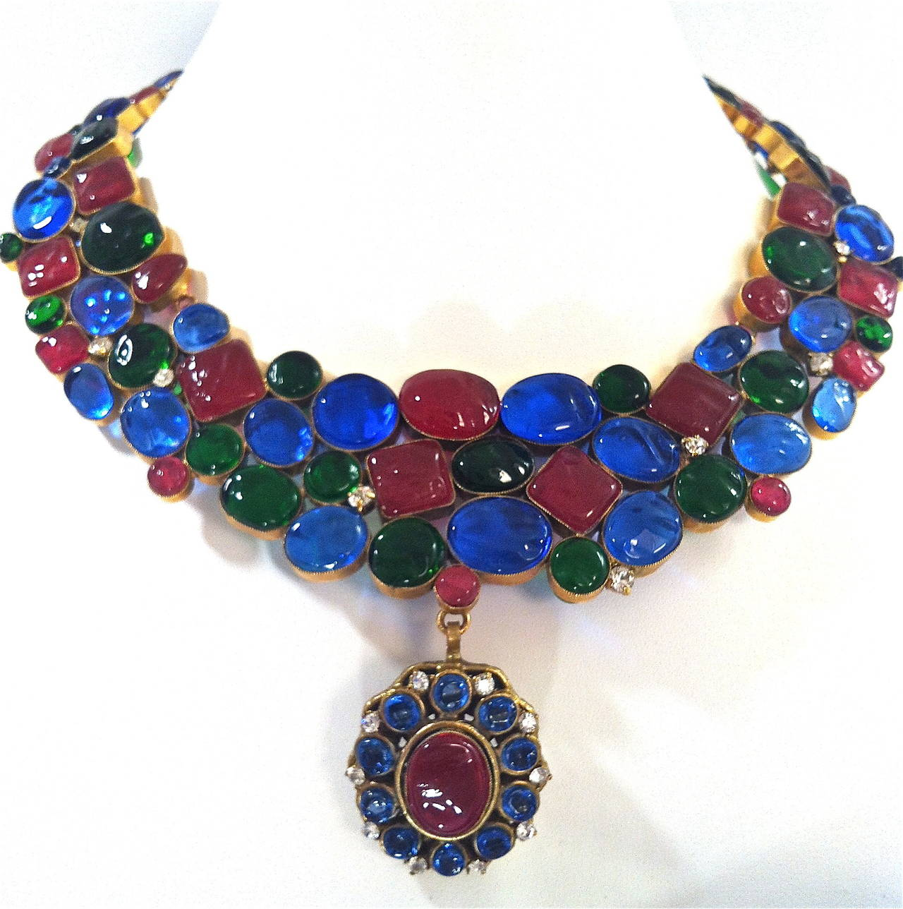 Made for Chanel, an exceptional open back Gripoix poured glass necklace consisting of 11 articulated segments, set with 89 poured glass cabochons framed in thin brass rings, imitating ruby, sapphire and emerald gems in the Byzantine style so loved