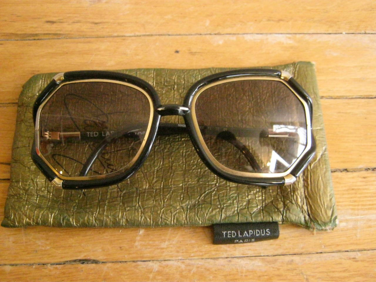 Beautiful oversized black and gold frame sunglasses. These sunglasses are in excellent condition, made in France and have their original soft case.