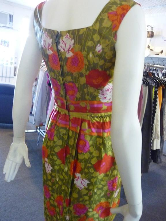 Beatiful old silk in a floral print with side bust pleats; defined waist and hidden zip. Jeannette Alexander is the daughter of the designer Peggy Hunt.