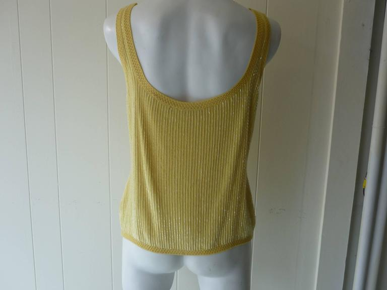 Rows of beads cover this yellow top which is trimmed with a delicate open cotton weave.  Content: 21%WS, 21%SE, 18%WO, 40%VI  This top was made in Italy, and comes with extra beads  Please note there are a couple of beads missing on the shoulder