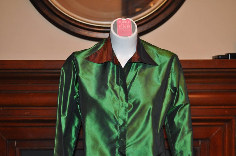 Beautiful combination of shiny green silk with a brown collar and velvet brown trim on scalloped reversible cuffs, The neckline can be buttoned up or left open, and front closure is by hidden button. Will enhance any outfit!