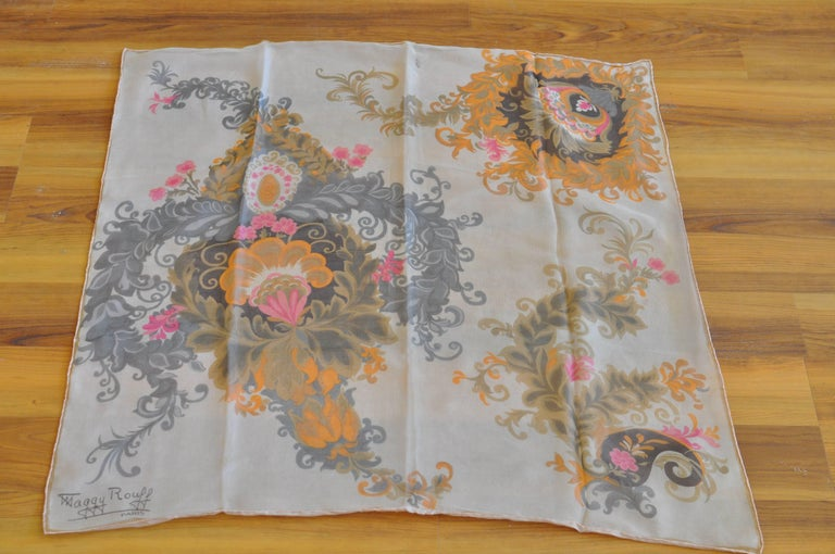 Etheral flower print silk chiffon scarf with a silk backing layer; hand rolled hems and signed.
