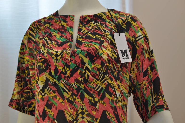 Easy to wear and travel with this Missoni silk dress has a hidden side zip closure; short sleeves, and a round neckline with a nice slit opening. The print is reminiscent of an abstract painting.