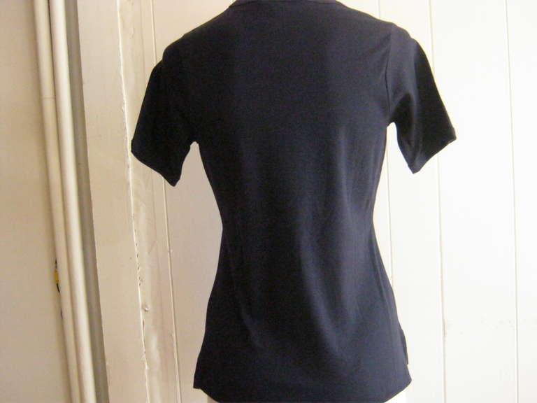 This dark blue cotton t-shirt with the red Givenchy logo, has never been worn and still carries its tags.  Could be this year's and would look terrific with a pair of slim pants or capris.