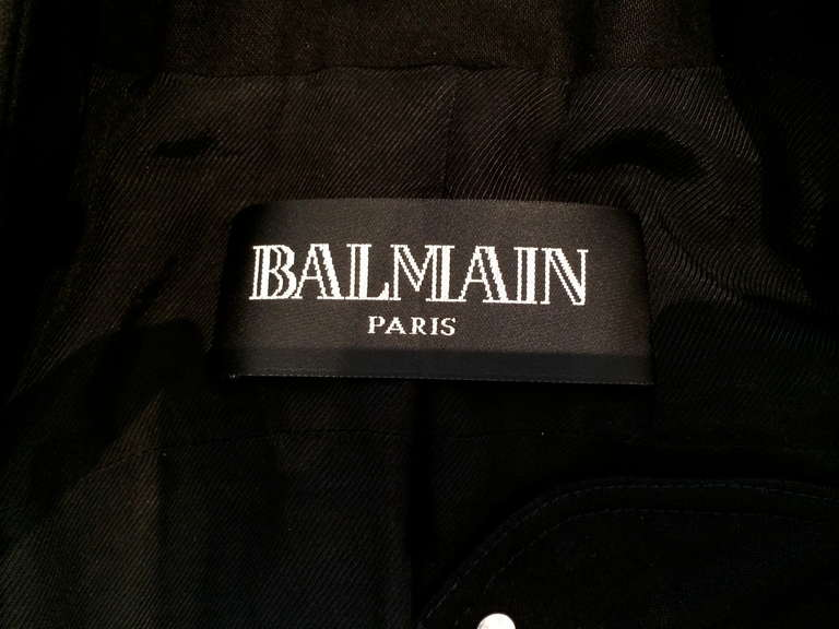 Beautiful Balmain collector's piece. This motorcycle jacket has intricate beading on arms, shoulders and waist. Zippers at the wrist. 