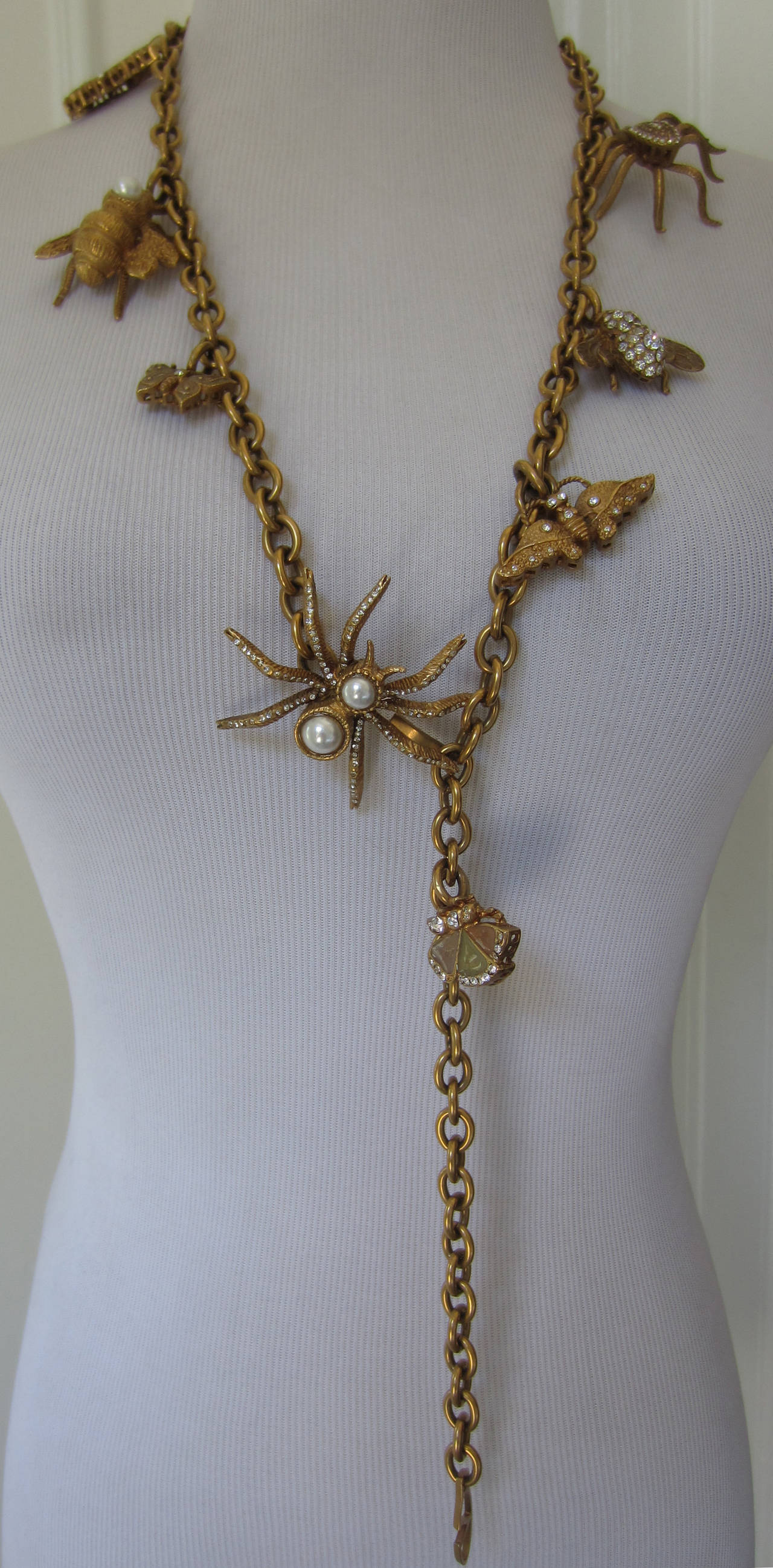 This  rare Valentino charm belt is whimsical and unique. Charms are featured as little creatures adorned with pearls and stones... Can be worn as a necklace as well... Have fun with this wonderful piece of jewelry/belt...
