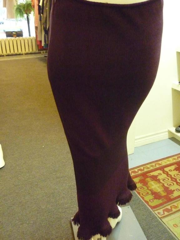 Lovely 50/50 wool and rayon skirt. The material is ribbed with three different patterns, the middle one having the feel of a bandeau and a slightly deeper aubergine color.  The bottom part of the skirt has a bit of an a-line as well as wispy wool