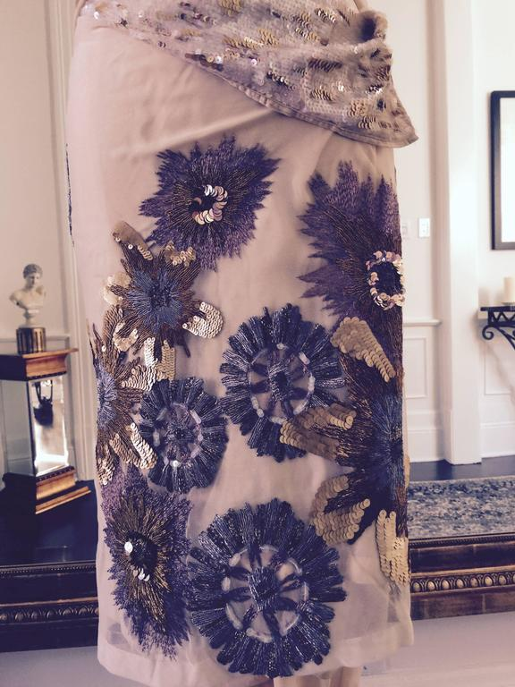 This unique 3 piece set by Dries Van Noten is just beautiful and so feminine with its intricate embroidery , it will make you feel like an exotic goddess. All in silk, pull on pant, wrap skirt and sexy tank top... Bohemian chic
