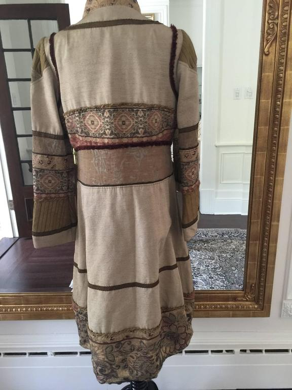 A very unique silk blend coat by Gary Graham, it very boho chic in feeling with its intricate and delicate jacquard trims, button front with bell decorated sleeves.
