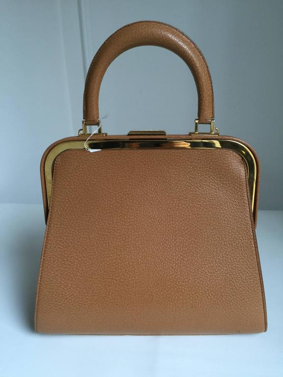 This Christian Dior bag is...a classic...with gold hardware...