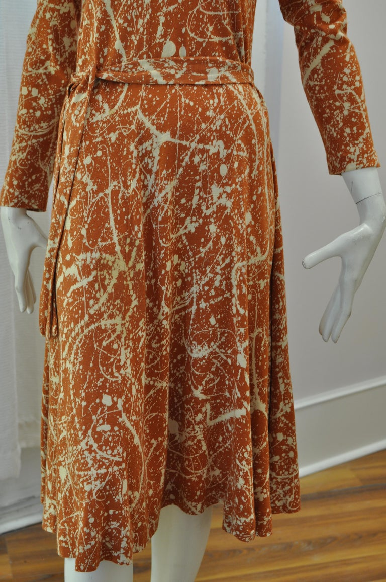 This is a very special  DVF dress in burnt orange and white made in Italy. The dress can be worn with or without the belt. The material is an acrylic jersey.