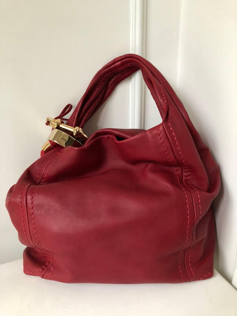 16ec808de0 This iconic jimmy Choo bag has graced the arms of many celebrities. It is an