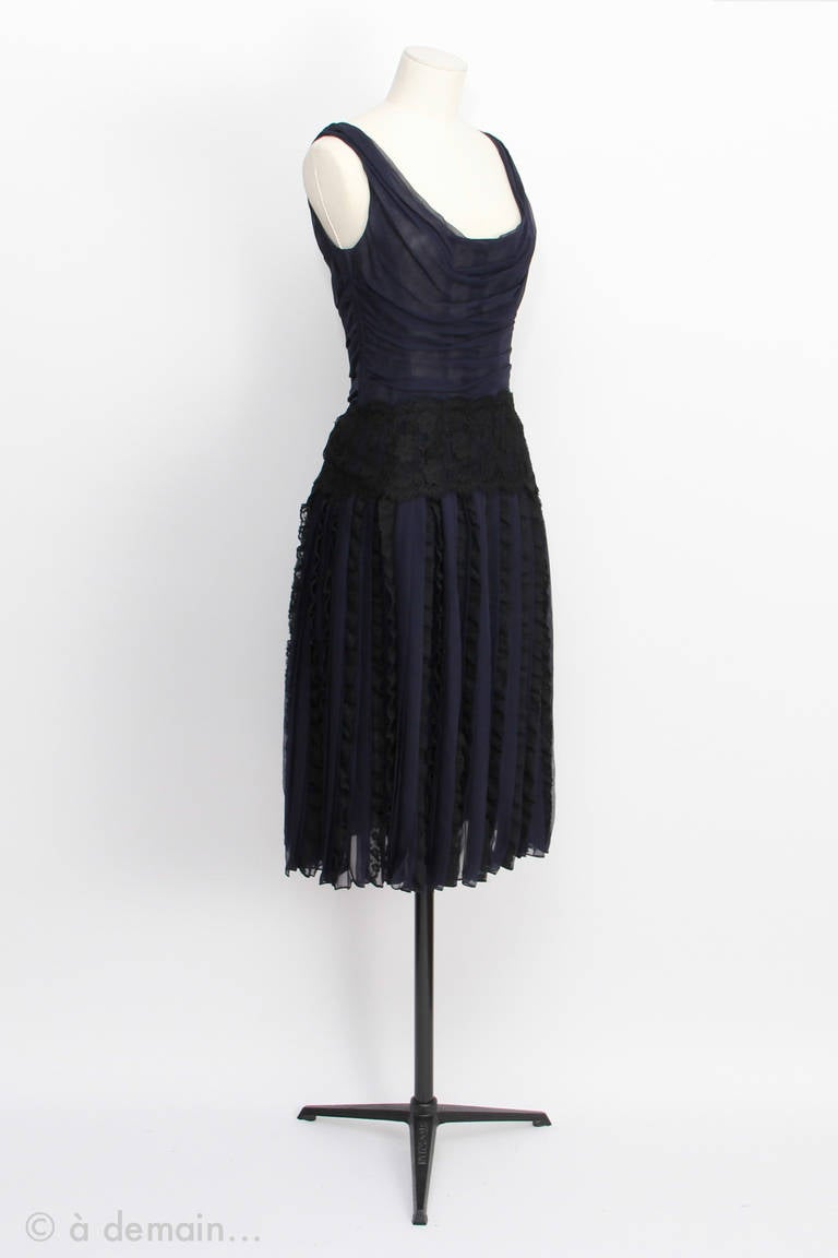 Dolce Gabbana Haute Couture Dress in blue chiffon silk and black lace. Zipper on the side. Corseted chest and pleated half-slip. From 1990s to 2000s.  Eur Size 36  Chest: 40 cm  Waist: 35 cm  Total height: 110 cm