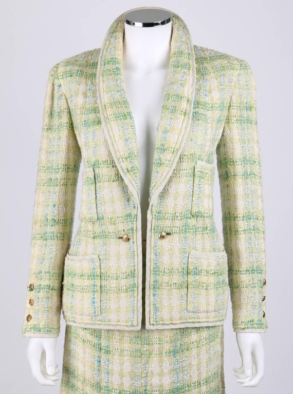 "Vintage Chanel Boutique Spring/Summer 1984 two piece tweed skirt suit in shades of pale green, teal and ivory. The jacket is trimmed in textured pale green silk. Four patch pockets. Closes at front with gold-tone ""CC"" signature buttons on a chain."