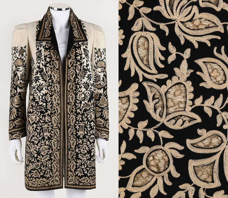 Vintage c.1910's Edwardian one of a kind couture beige and black felt coat. Intricately detailed cutwork with metallic lace insets and crewelwork and metallic embroidery detail. Long sleeve. Spread collar. Open front. Pleated/tucked detail at the
