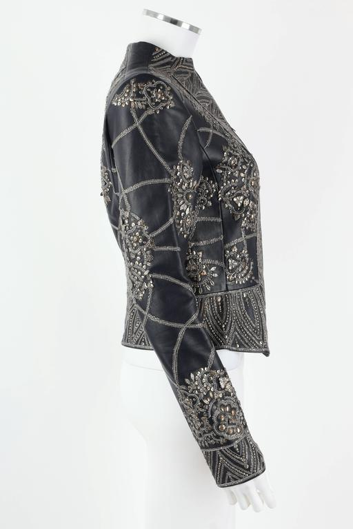 Oscar de la Renta Autumn/Winter 2006 collection navy blue genuine lambskin leather jacket. Heavily embellished with antique finish metallic sequins & embellishments in geometric pattern. Zips at front. Fully lined. Marked Fabric Content: