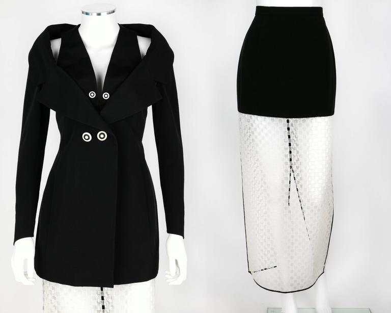 "Vintage 1980's Karl Lagerfeld two piece Avant Garde skirt suit. Jacket has a layered/structured collar. Black and white contrasting ""target"" button detail. Buttons at front and at cuffs, and closes with hooks and eyes at layered collar. Fully lined."