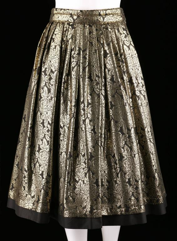 Fall/Winter 1983 New Old Stock Gianni Versace gold and black silk floral lame skirt. Full pleated skirt. Quilted waistband. Black trim at hem. Two pockets. Hook/eye and button closure at hip. Tulle was photographed with this item, which is not