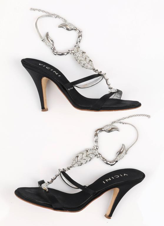 Vicini by Giuseppe Zanotti Limited Edition 2015 black satin scorpion embellished high heels. Upper is detailed with a large silver & diamond-rhinestone embellished scorpion design. Open toe. Back ankle strap is silver chain with adjustable hook.