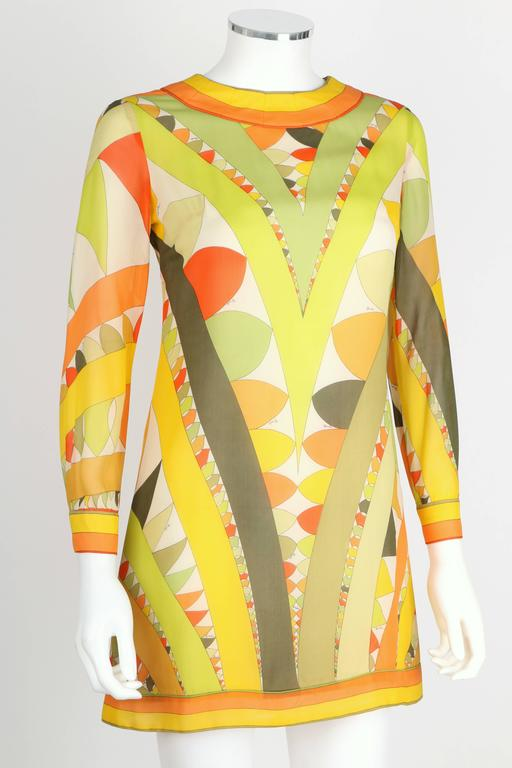"Vintage c.1960's Emilio Pucci signature print silk chiffon/georgette shift dress in shades of green, orange, yellow and white. Jewel neckline. Long sleeves button at fitted cuffs. Back center zipper. Lined. Marked Fabric Content: ""100% Pure Silk""."